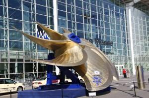 Huge golden ship propeller in front of exhibition hall