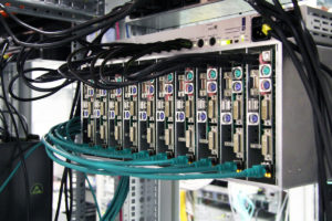Setup of an IP matrix test. Many small devices connected by cable to an IP matrix.